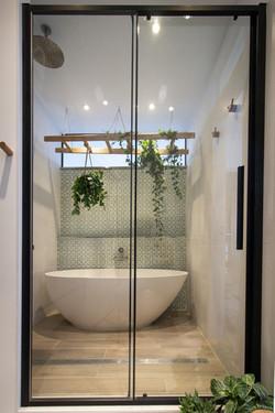 Shower enclosure or bathtub oasis?