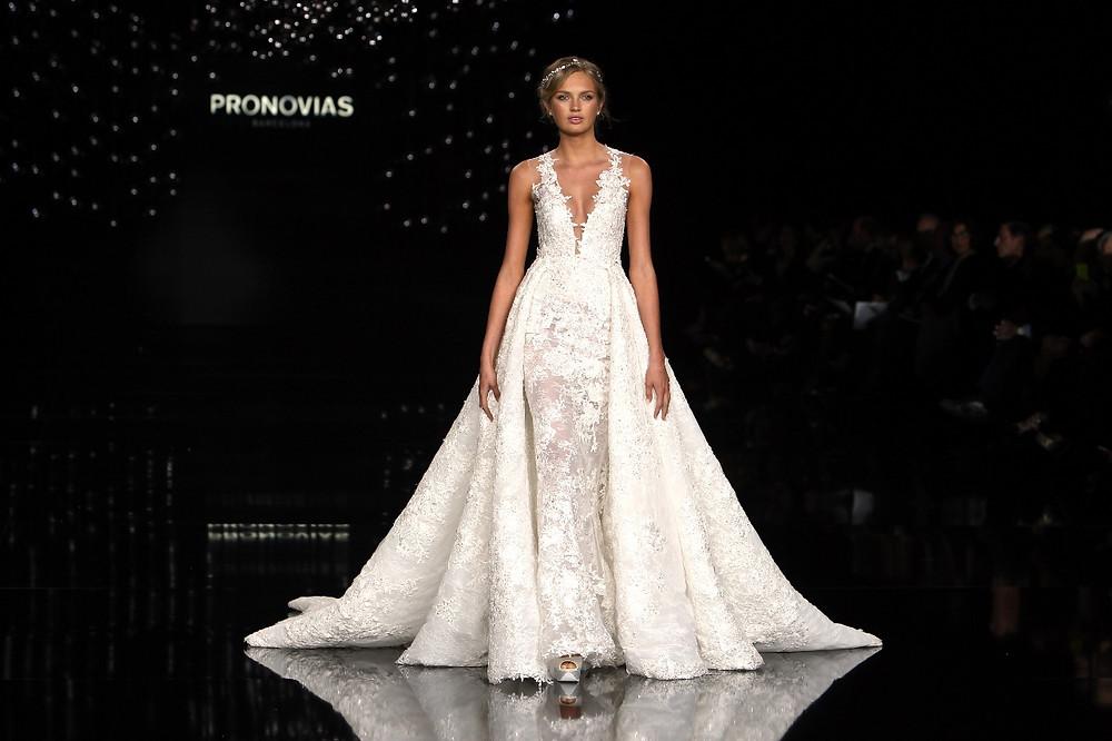 Pronovias plunge neck llusion print gown with detachable train