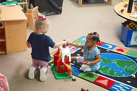 Toddlers playing in nursery