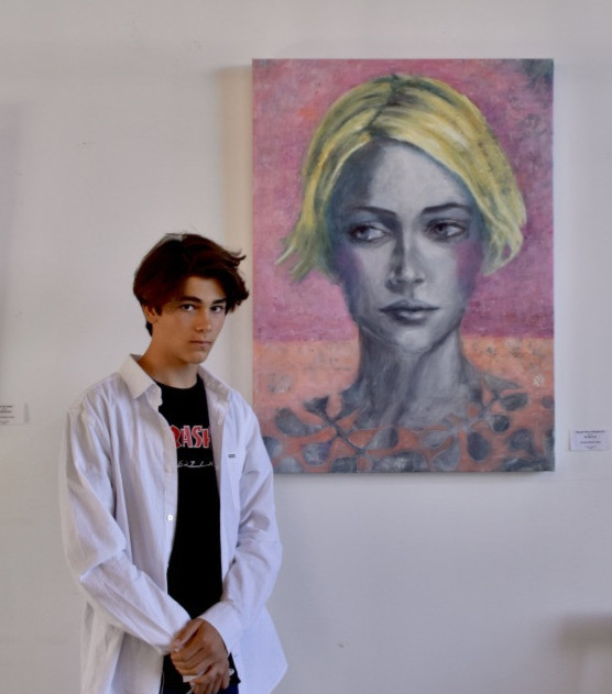 Young man with his fav painting of the art show