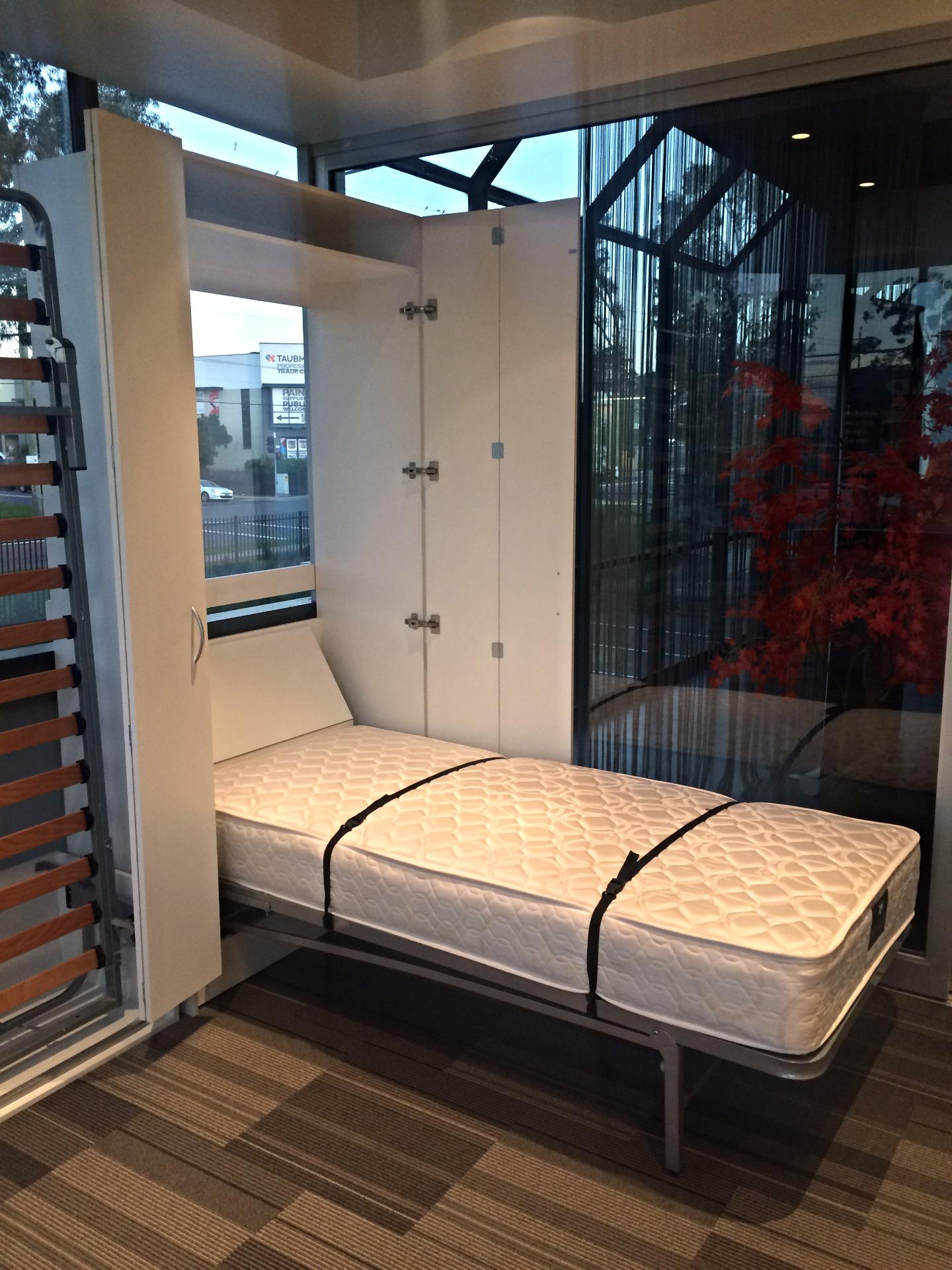 Bi fold door cabinet and bed open