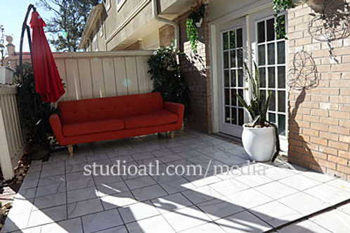Red couch in the patio