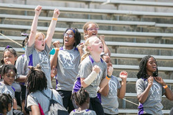 girls middle group cheering from stands