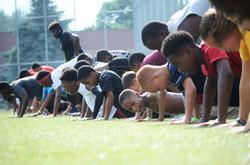 football players warming up