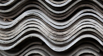 Corrugated asbestos cement sheets.  OnPoint can assess your facility for asbestos for compliance or in advance of construction projects that impact it.