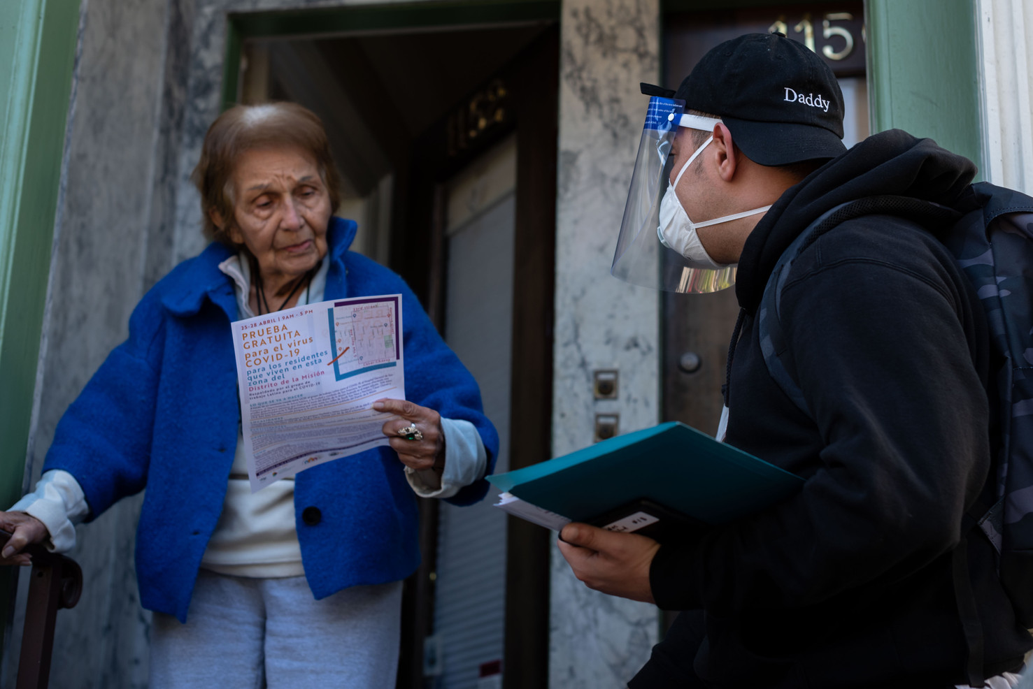 Rafael Gonzalez, an AIDS researcher with the City of San Francisco canvasses door-to-door urging and pre-registering residents in the Mission neighborhood of San Francisco for free mass COVID-19 testing.