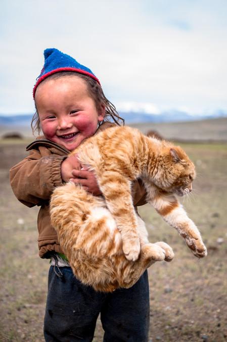 Esen's daughter and her cat.