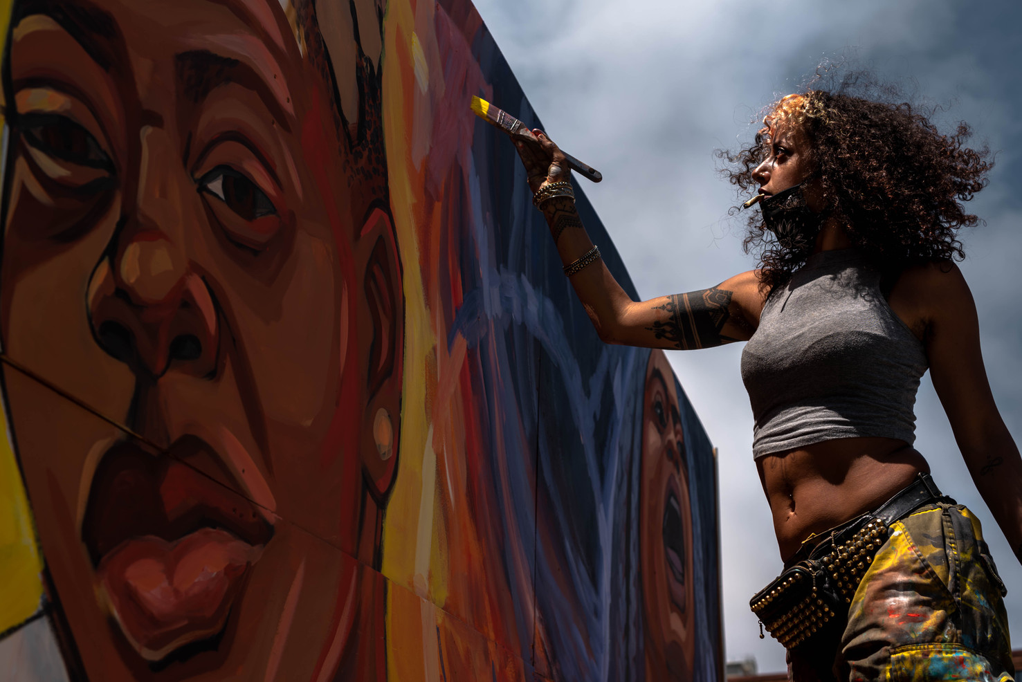 """""""For those who passed to move peacefully to the other side and that we make the world safer and more loving. So those who are with us may thrive in their full expression."""" - Oakland artist Rachel Wolfe Goldstein paints and dedicates her work to trans individuals during a Juneteenth festival highlighting black artists held by the African American Art & Culture Complex."""