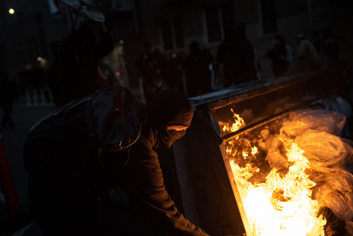 Angry rioters set a dumpster ablaze after curfew as dozens of police in riot gear break up a Black Lives Matter protest at San Francisco City Hall.
