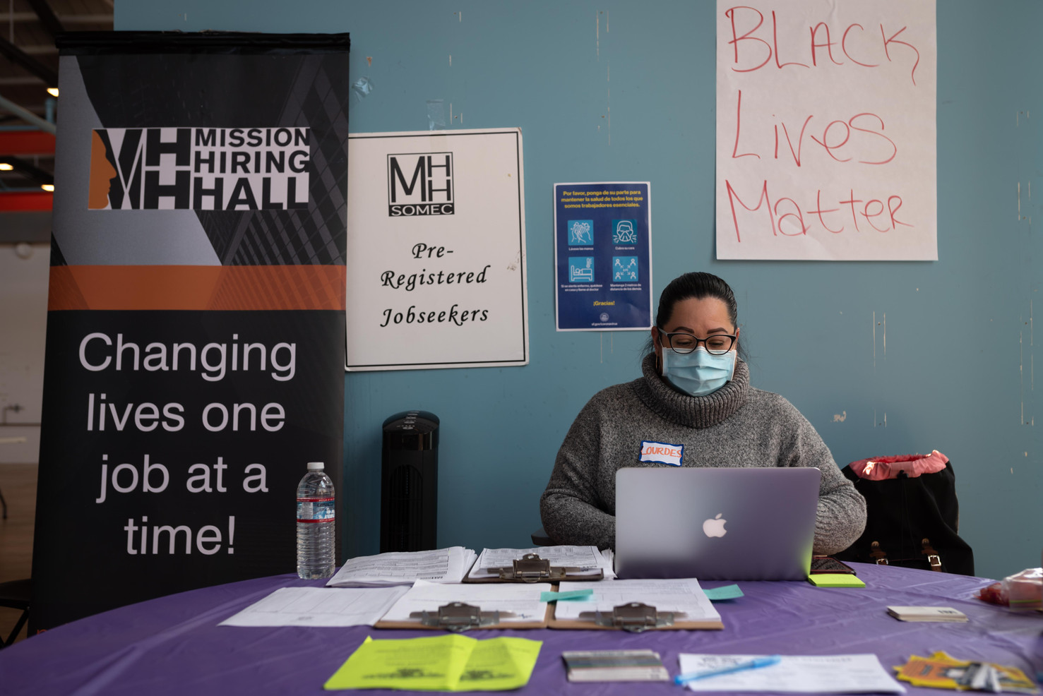 Lourdes Beltran of Mission Hiring Hall helps Mission Latino community members apply for employment opportunities