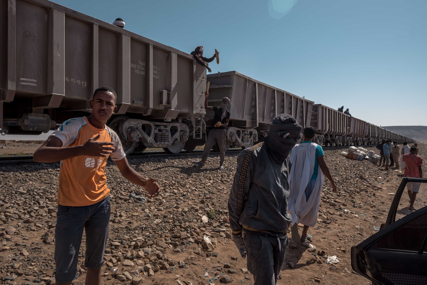 After 14 hours, the train makes a stop at a tiny village called Choum. Everybody scrams to toss their luggage over the side before the train continues toward the mines.