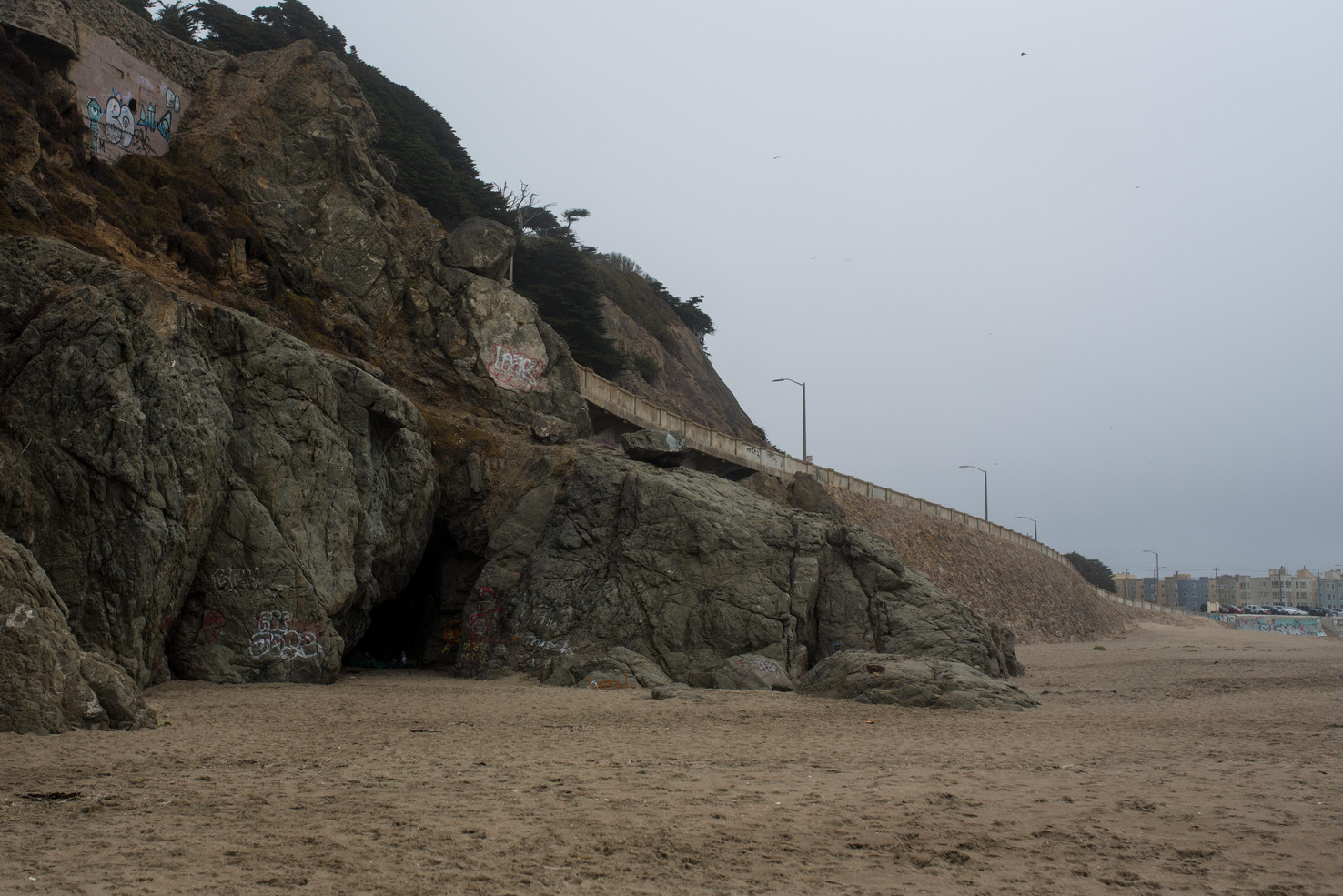 A cave many of San Francisco's homeless choose to stay temporaily. At the very end of the beach, most residents avoid the area. The closest houses are visible in the background.