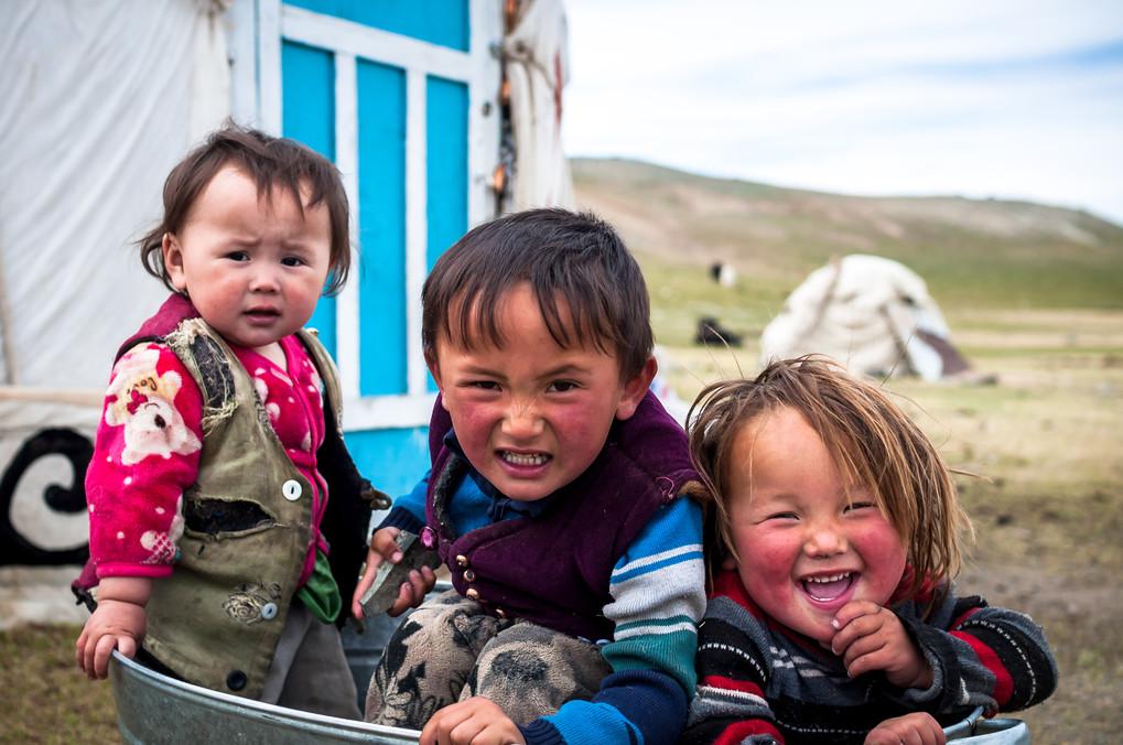 Esen's 3 children sit together in a tub.