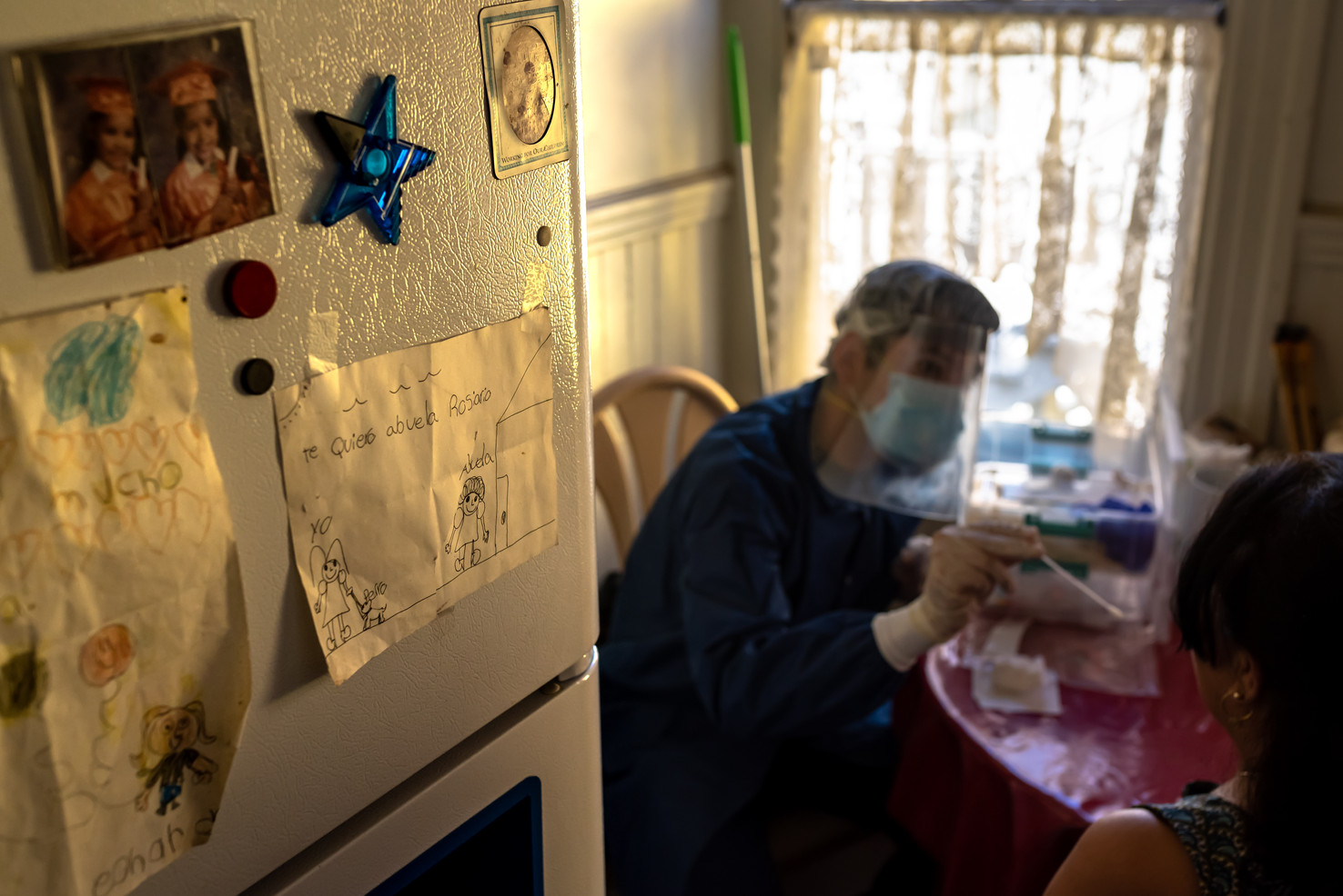 Maria Del Prosario, a Mission resident with preexisting conditions or unable to leave their homes during quarantine is tested via mobile in-home services partnered with Unidos en Salud.