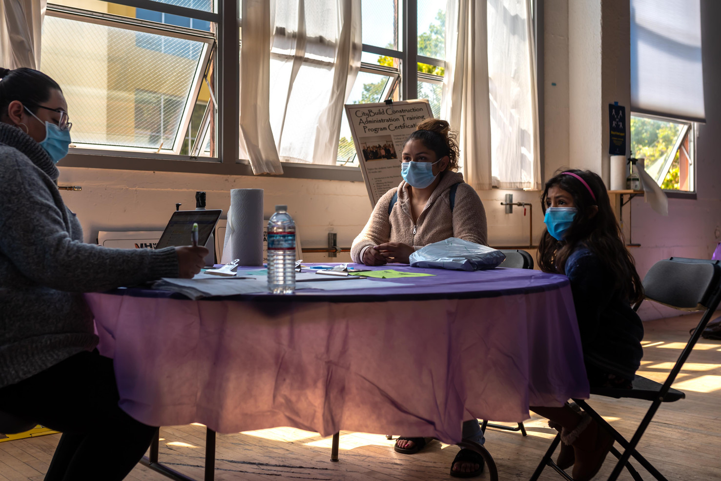 Six year old Kimberly accompanies her mother Karen Romero to apply for employment opportunities with Mission Hiring Hall at the Latino Task Force Resource Hub on 701 Alabama St. Every Thursday, the Latino Task Force for COVID-19 provides testing, food distribution, and essential services such as employment and housing resources.