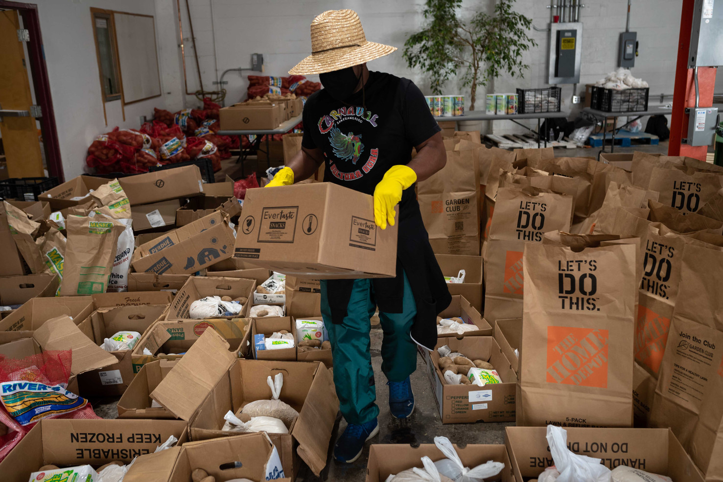 Tadd Scott, a teacher at Mission Highschool, volunteers to distribute food to hard hit community members at Latino Task Force Resource Hub. The Hub provides weekly testing, food distribution, and essential services such as employment and housing resources.