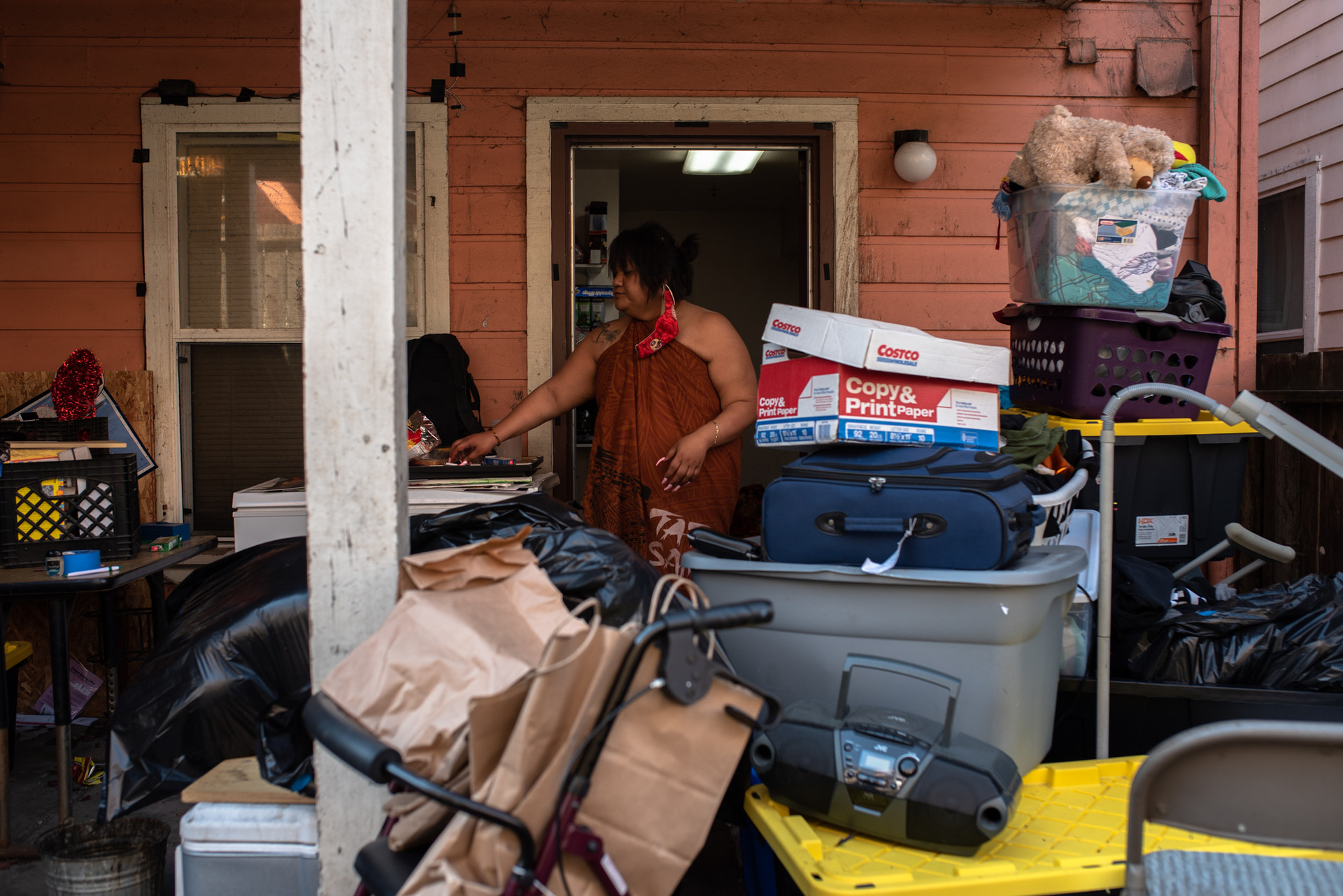 Gaynor's younger sister Jennifer moves all her belongings into the backyard as the family packs everything into boxes. The city recently gave Gaynor's family 7 days notice to vacate for renovation.