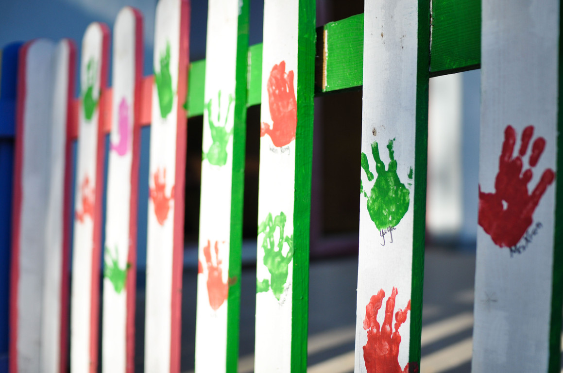 Hand prints of the kids during the repainting of the playground fence.