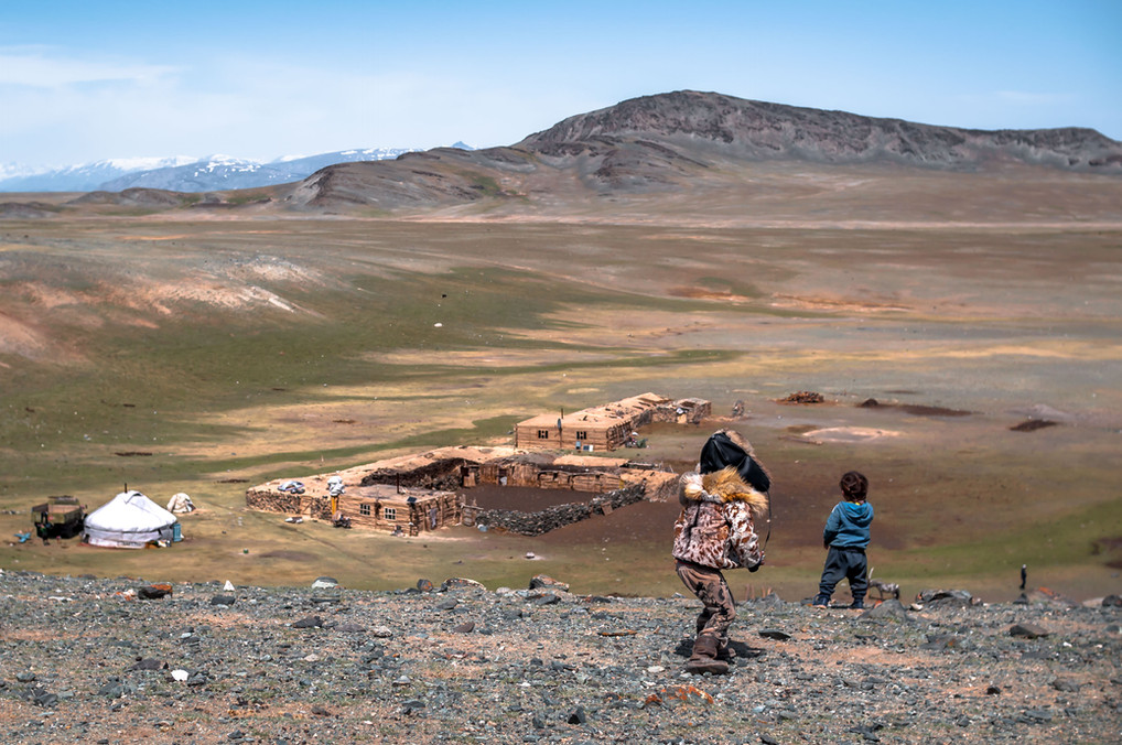 Two of Esen's children overlook their home. The wooden structures were build by their grandfather and uncles over multiple decades. As Esen was only recently married, their family temporaily lives in the tent (left).