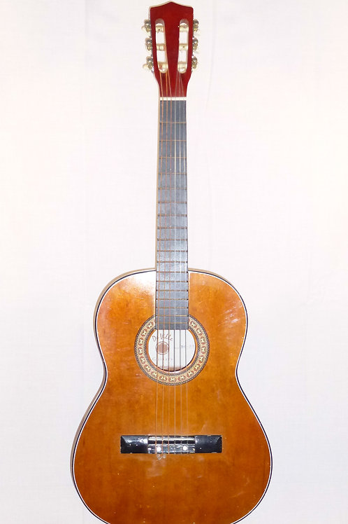 A 3/4 size nylon string guitar ideal for a child
