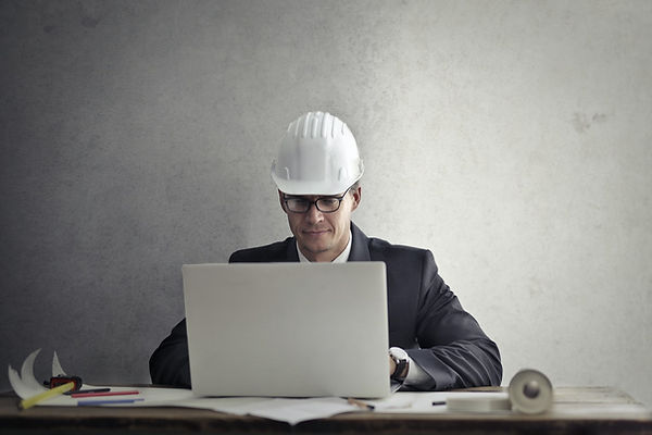 engineer-working-with-laptop-at-table-37