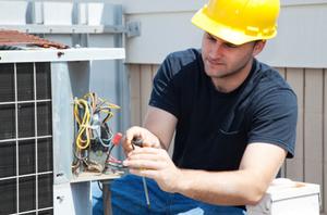 Repairman doing maintenance on a HVAC system