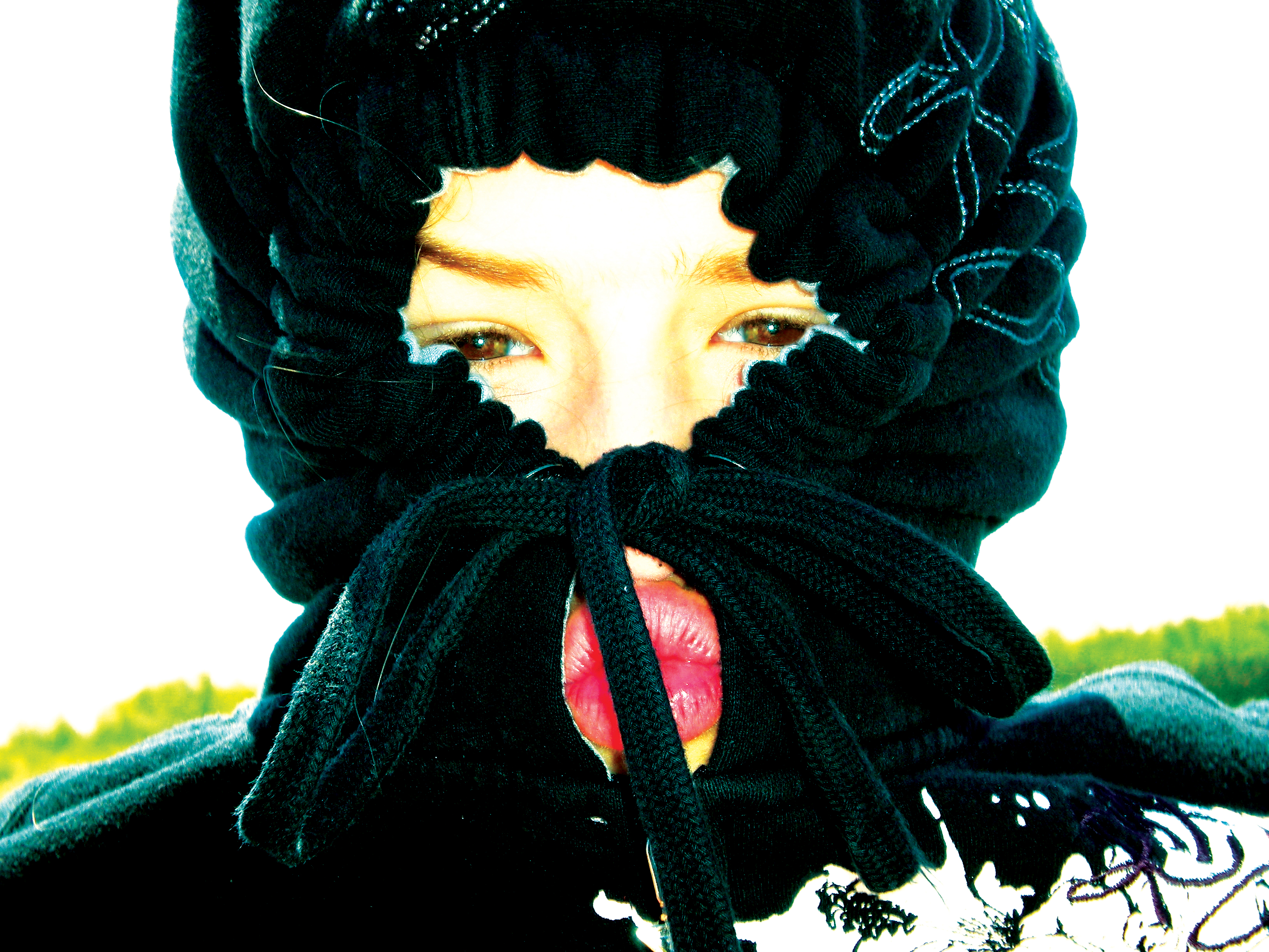 teen in hoody covering face