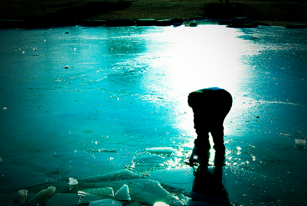 kid on frozen lake