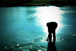 kid on frozen lake