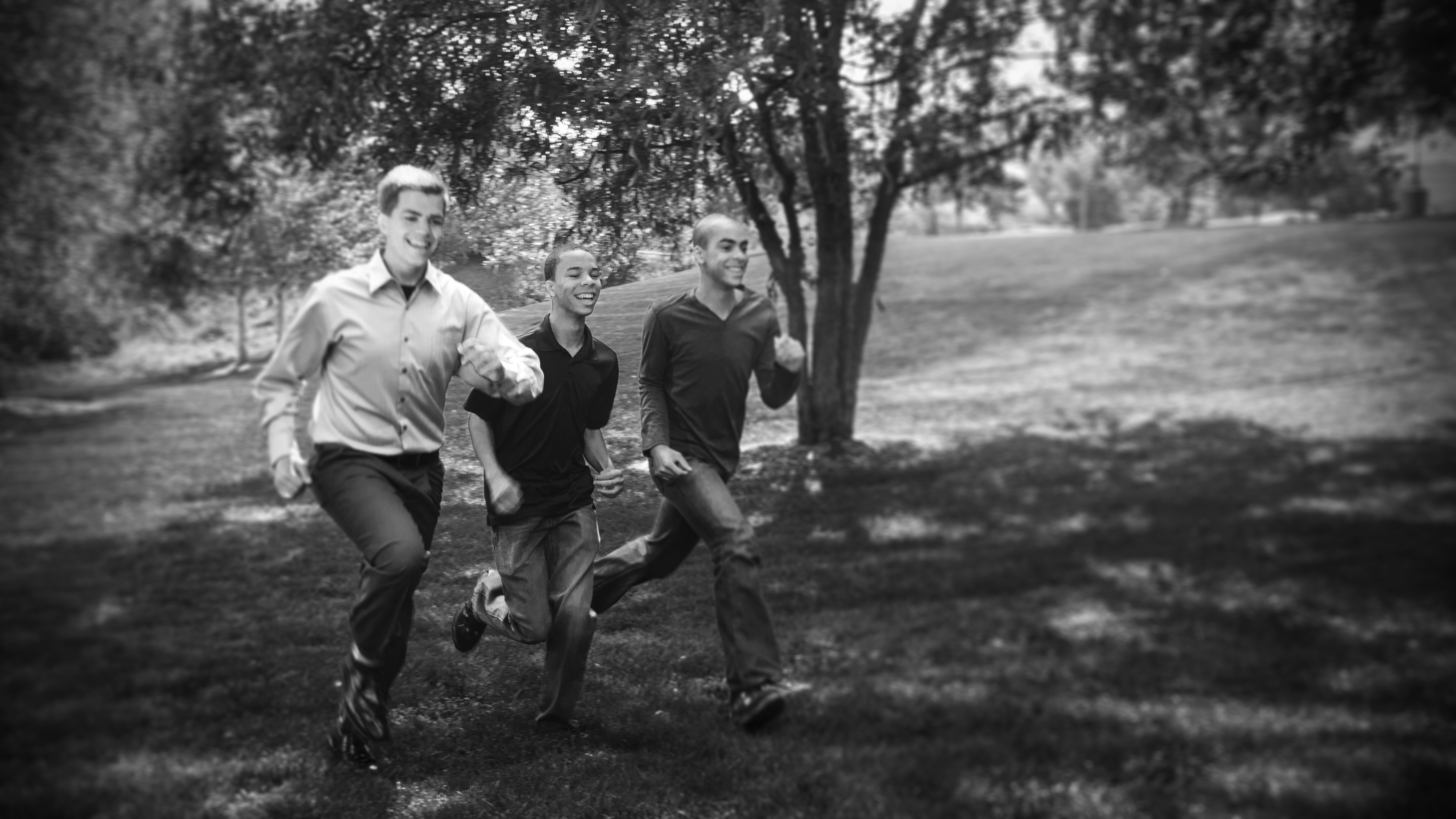 teens running black white
