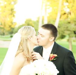 bride groom kissing colorado photo