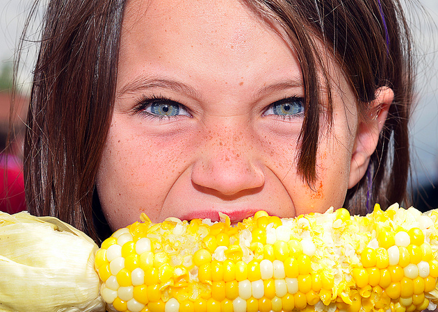 girl female eating corn