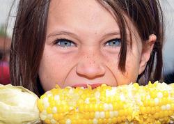 girl female eating corn