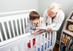 mom and baby crib reading