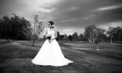 bride in grass black white