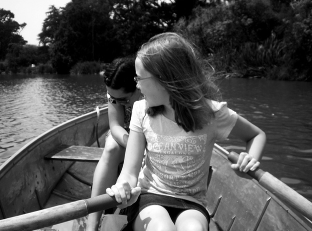 two girls row boat