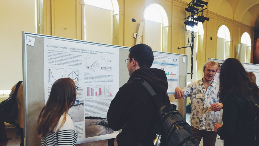 Hallie Fischman ('19) explains her senior thesis research project at Biology Research Day