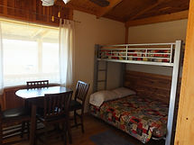 Cabin 1 Bunks, Beds and Dining Area