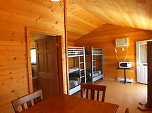 Cabin 2 Dining Area, Microwave and Bunks, Beds