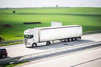 white-tir-truck-in-motion-driving-on-hig