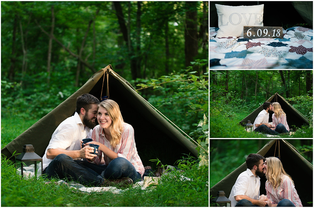 couple sitting in the middle of the woods sharing a kiss and coffee
