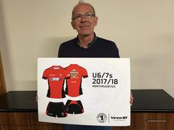 Rob with shirt sponsor board