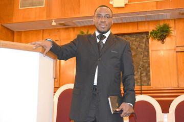 Photo of Pastor Gardner standing in pulpit