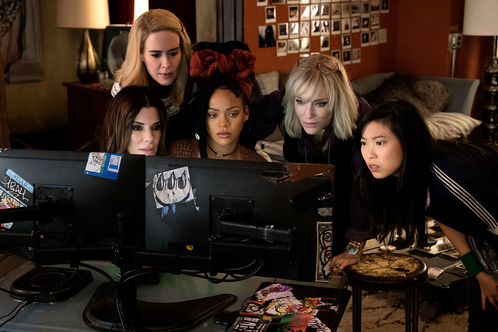 "This image released by Warner Bros. shows, from foreground left, Sandra Bullock Sarah Paulson, Rihanna, Cate Blanchett and Awkwafina in a scene from ""Ocean's 8."" (Barry Wetcher/Warner Bros. via AP)"