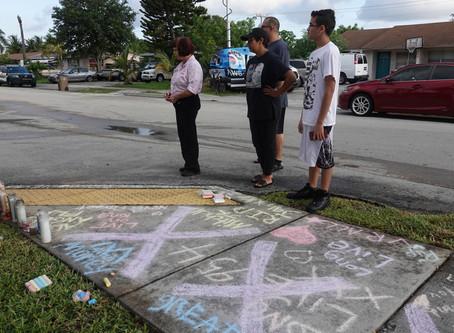 The Latest: Candles, teddy bear left on slain singer's porch