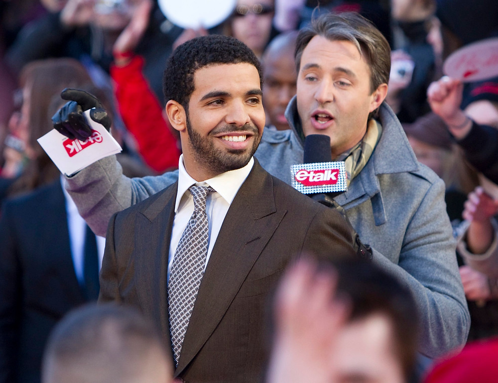 "FILE - In this March 27, 2011 file photo, Drake arrives on the red carpet at the 2011 JUNO Awards, Canada's music awards in Toronto. Drake is having a Degrassi Community School reunion. The rapper played Jimmy Brooks in the Canadian teen drama and a video released Wednesday, June 13, 2018, for his single ""I'm Upset"" features several of his ""Degrassi: The Next Generation"" cast mates. (Darren Calabrese/The Canadian Press via AP)"