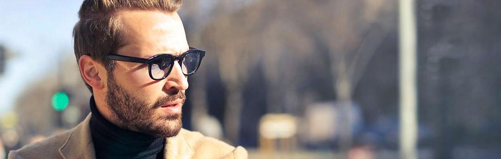 man-wearing-eyeglasses-and-brown-jacket-