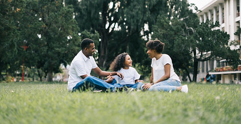 family-sitting-on-grass-near-building-1128316_edited.jpg