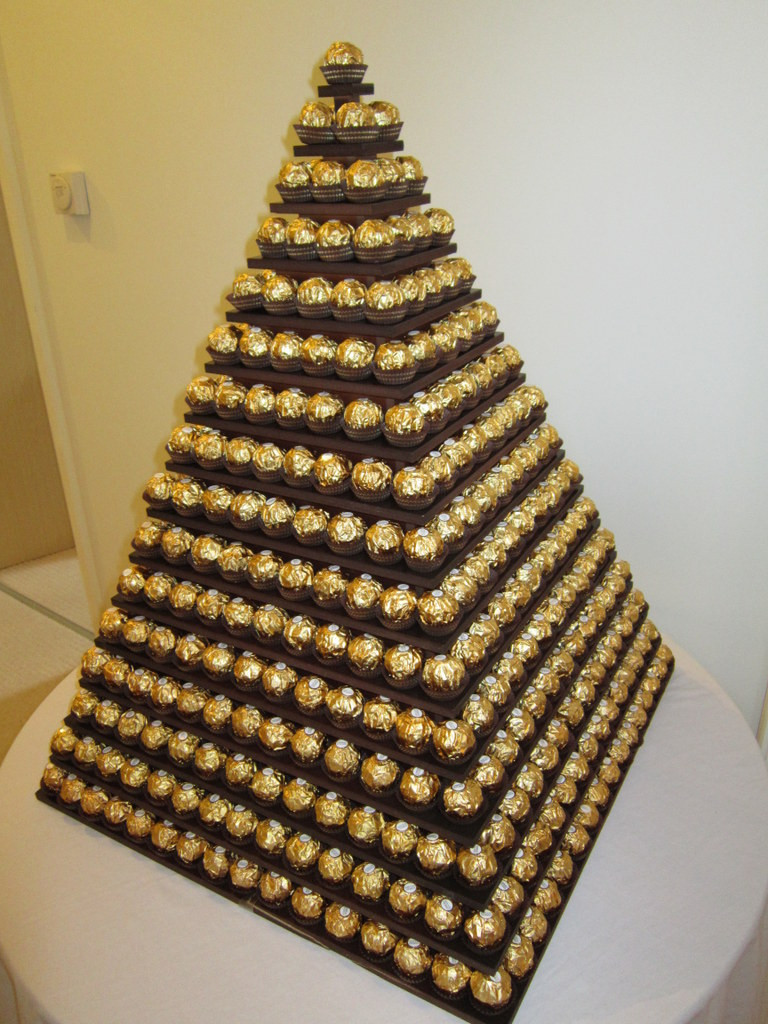 gold chocolate pyramid hire