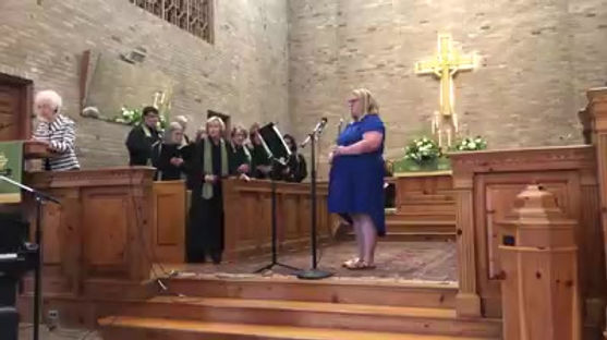 Listen to Abbi Williams play the flute during a church service.